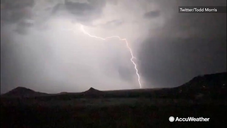 Bolts of lightning leap from the clouds during nighttime thunderstorm