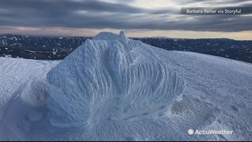 Stunning footage shows building encased in snow