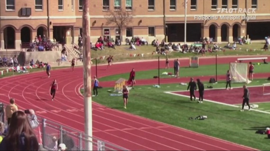Check Out This Super Fast Dog Catch Up to the Front of This High School Track Race!