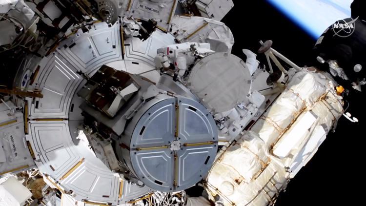 Spacesuit concerns briefly interrupt astronauts' spacewalk