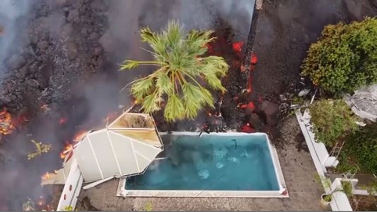 Drone video shows lava from Spain volcano destroy homes, swimming pool