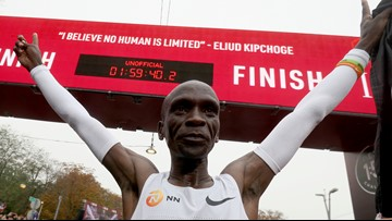 Kenya's Eliud Kipchoge is first to run a marathon in under 2 hours