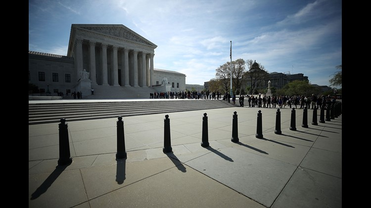 Supreme Court Hears Arguments in Challenge to Trump's Travel Ban