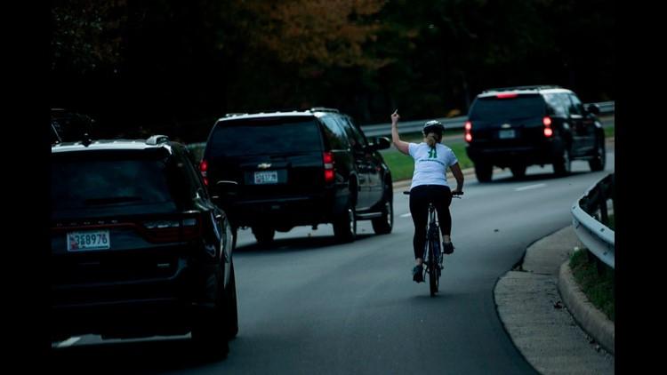 Virginia woman who flipped off Trump's motorcade sues employer