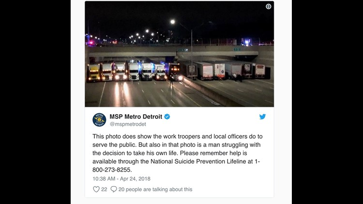Police organize 13 semis on Detroit freeway to save suicidal man
