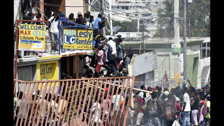 Looters pillaged burned and vandalized shops in Haiti's capital Sunday following two days of violent protests over the government's attempt to raise fuel prices. The U.S. Embassy in Port-au-Princewarned U.S. citizens to shelter in place. It noted that many flights were canceled.