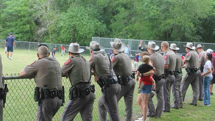 Texas DPS troopers line up to cheer on son of injured trooper at baseball game