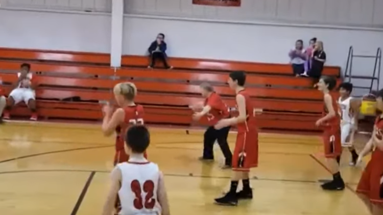 Team manager with Down syndrome scores in basketball game