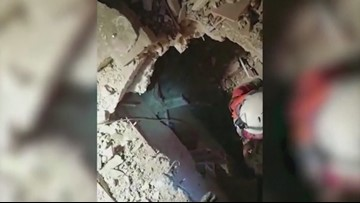 Dramatic Footage Shows Turkish Rescue Workers Saving Woman And Child From Collapsed Building