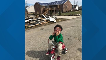 """""""That's what God wants us to do""""   Little boy rides his tricycle to help tornado victims"""