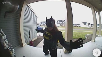 Grandmother surprises grandchildren at their windows every day with a new costume