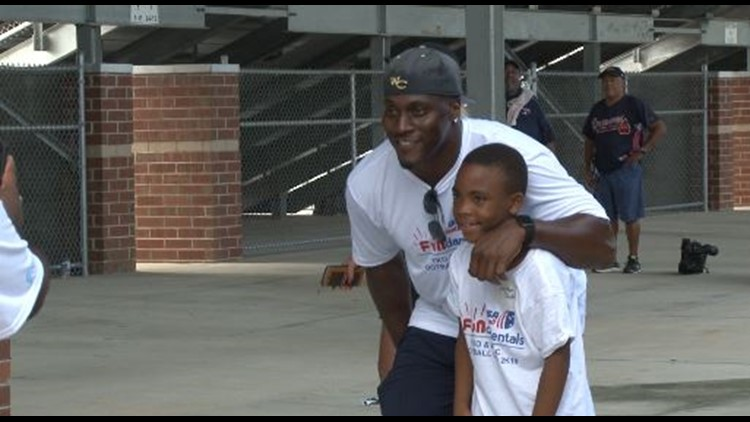 'What we provide is hope:' NFL veteran Takeo Spikes hosts 16th annual football skills camp
