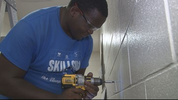Bibb County graduate hired as full-time district employee right out of high school