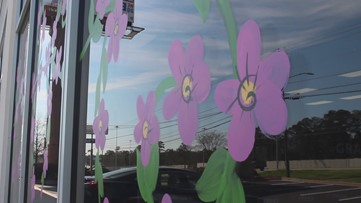 Who paints cherry blossoms on cars in Macon?