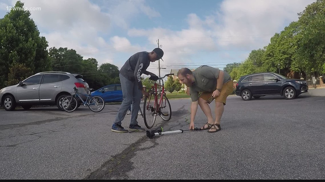 Macon man gives bike, cart to support teen's summer lawn business