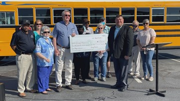 Laurens County bus drivers surprise former colleague with check