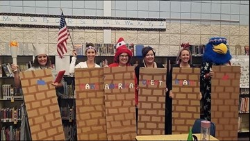 'We are better than this:' Teachers dress up as border wall, Latinos for Halloween
