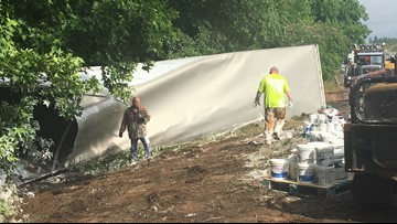 Semi-truck crash in Monroe County spills paint into creek