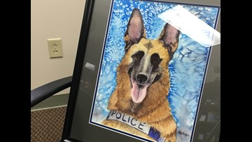 Artist dedicates portraits to late Byron K-9 officer Senta