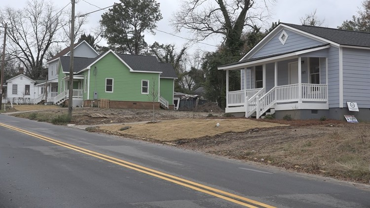 These three homes were moved across I-75 and restored in Pleasant Hill.