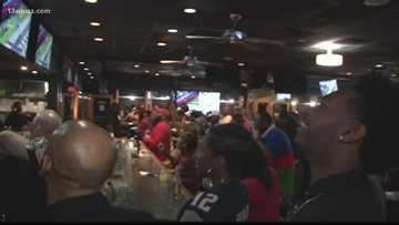 Fans gather at Overtyme Bar & Grill in Macon to watch the Super Bowl