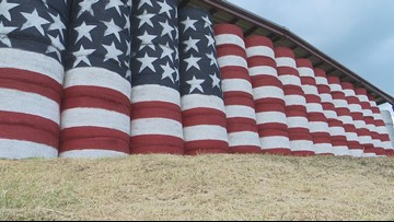 'It comes from the heart:' Johnson County farmers paint barn-sized American flag