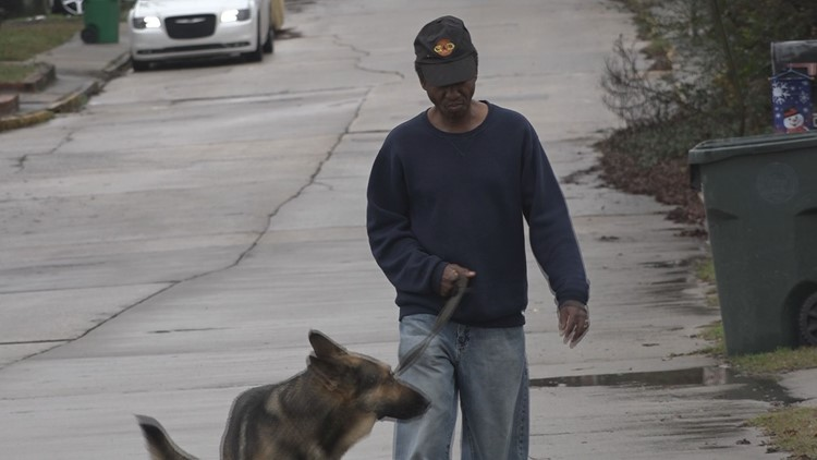 Leonard Jolley walks his German Shepherd Rusty in Pleasant Hill