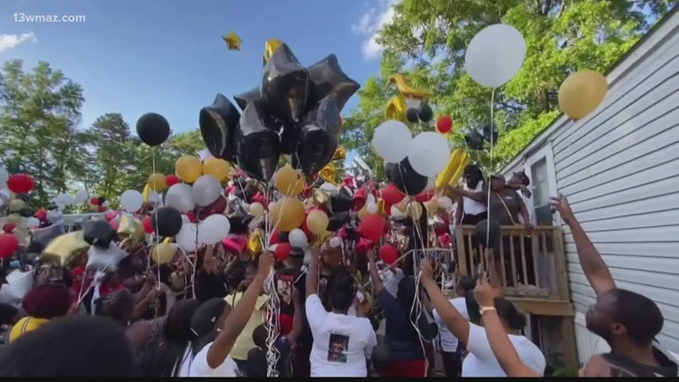 Family, friends gather for balloon release in honor of 2 killed in Macon mobile home shooting