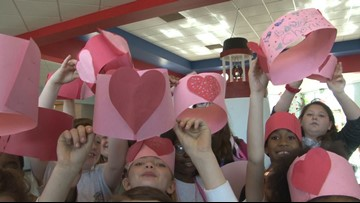 Elementary school chorus delivers Valentine's singing telegrams