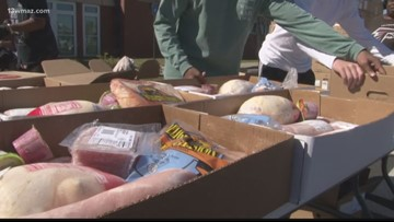 Organizations help hand out food to fight hunger