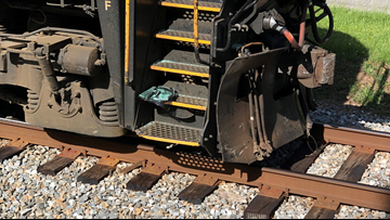 Train crashes into car in Monroe County