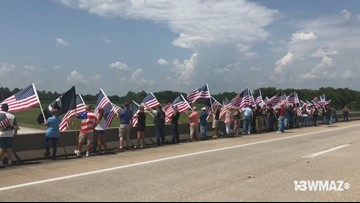 Flags line I-75 overpass in Warner Robins
