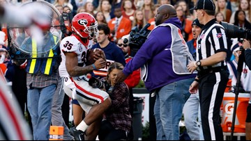 Photographer hit in Georgia-Auburn game out of hospital