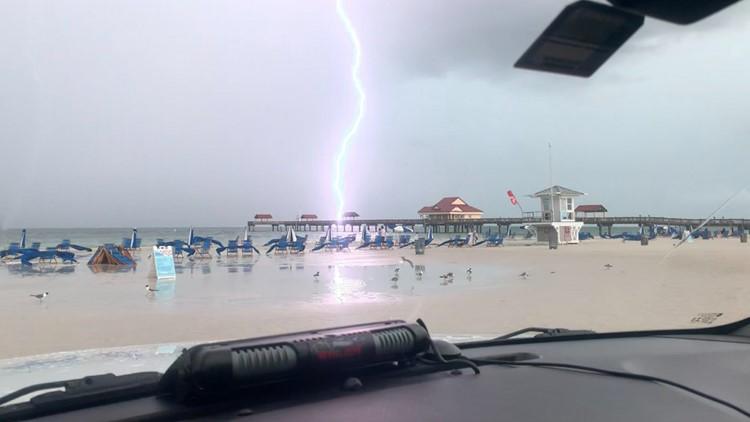 Photos show lightning striking near people on Florida beach
