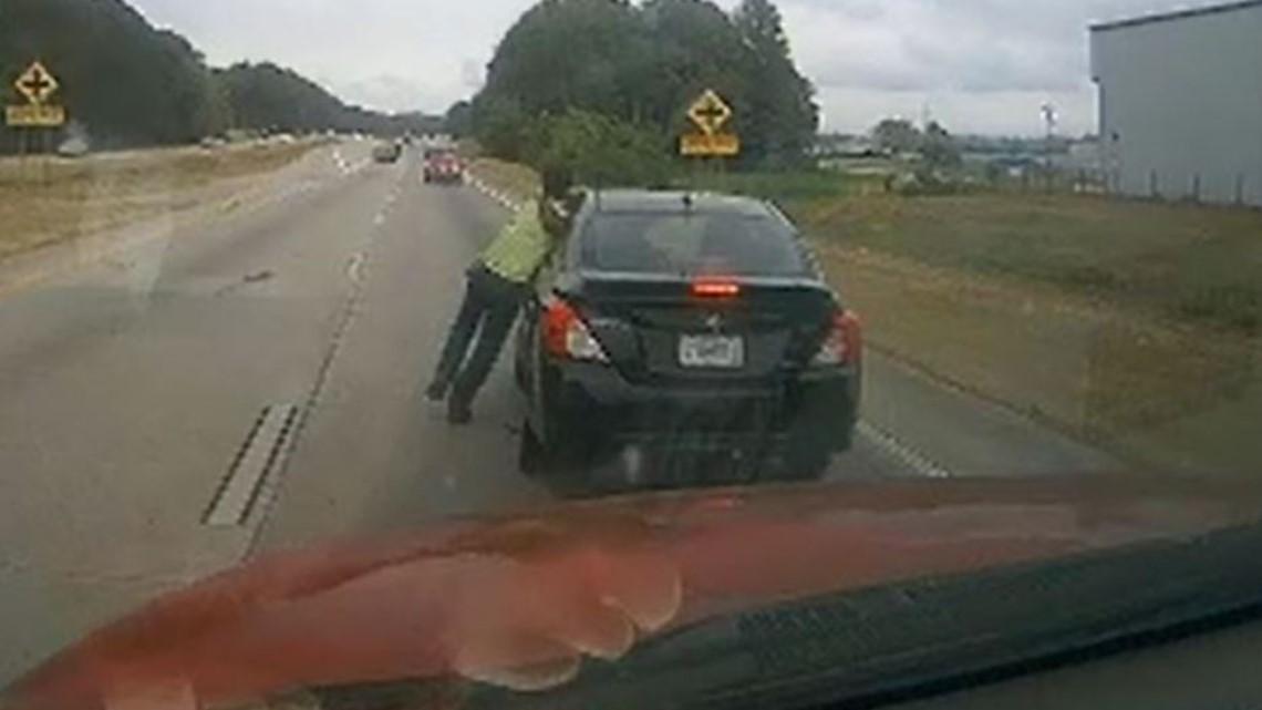 Dashcam video: Man dragged by car down road in a headlock