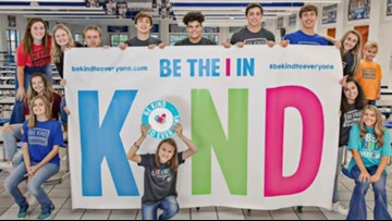 School banner inspired by  young girl with autism aims to spread kindness