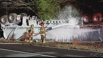 I-985 accident involving overturned 9,000-gallon gas tanker shuts down highway