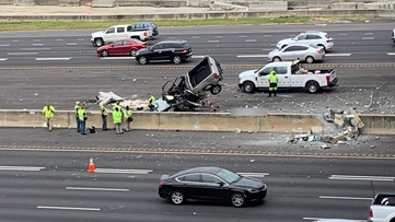 Person dies after truck crashes onto I-75 off overpass in