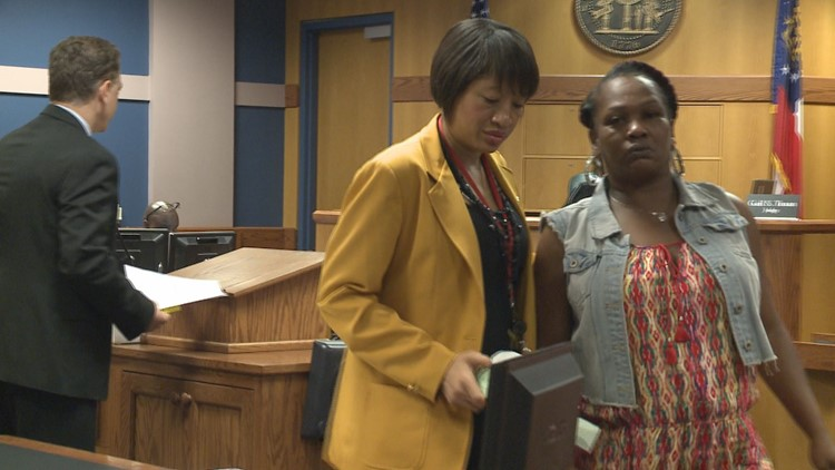 Kejuan Mason's grandmother (to the far right) leaves the podium after asking the judge not to lower Glenndria Morris' bond.
