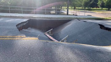Large sinkhole shuts down road between Rockdale schools in Conyers