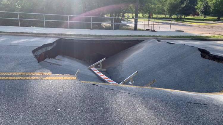 Large sinkhole shuts down road between Rockdale schools in Conyers